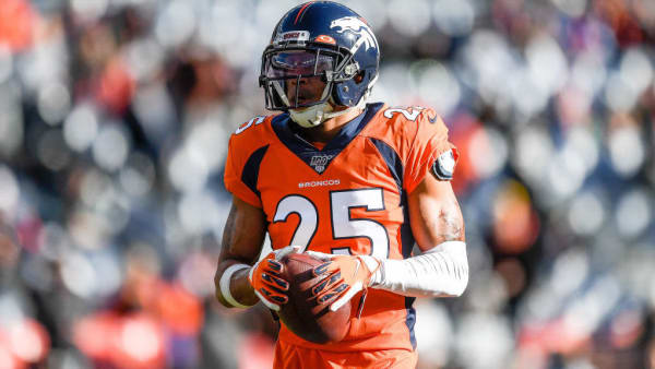 Chris Harris holds the ball against the Raiders.
