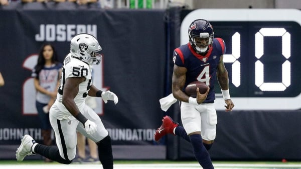 HOUSTON, TEXAS - OCTOBER 27: Deshaun Watson #4 of the Houston Texans runs past Nicholas Morrow #50 of the Oakland Raiders during the first half at NRG Stadium on October 27, 2019 in Houston, Texas. (Photo by Bob Levey/Getty Images)