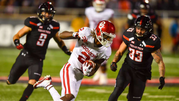 LUBBOCK, TX - NOVEMBER 03: CeeDee Lamb #2 of the Oklahoma Sooners gains yardage after making the catch  during the second half of the game against the Texas Tech Red Raiders on November 3, 2018 at Jones AT&T Stadium in Lubbock, Texas. Oklahoma defeated Texas Tech 51- 46. (Photo by John Weast/Getty Images)