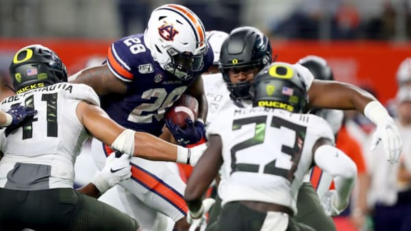 ARLINGTON, TEXAS - AUGUST 31: JaTarvious Whitlow #28 of the Auburn Tigers carries the ball against the Oregon Ducks in the fourth quarter during the Advocare Classic at AT&T Stadium on August 31, 2019 in Arlington, Texas. (Photo by Tom Pennington/Getty Images)