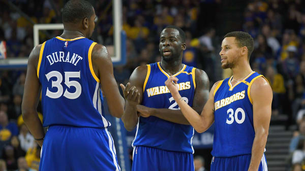 OAKLAND, CA - NOVEMBER 13:  Stephen Curry #30, Kevin Durant #35 and Draymond Green #23 of the Golden State Warriors talks while there's a break in the action against the Phoenix Suns during an NBA basketball game at ORACLE Arena on November 13, 2016 in Oakland, California. NOTE TO USER: User expressly acknowledges and agrees that, by downloading and or using this photograph, User is consenting to the terms and conditions of the Getty Images License Agreement.  (Photo by Thearon W. Henderson/Getty Images)