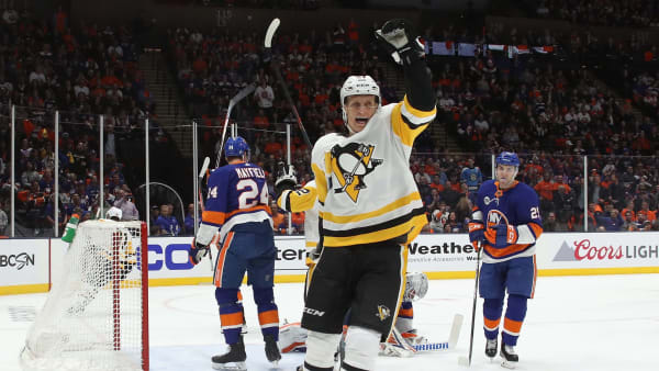 UNIONDALE, NEW YORK - APRIL 10: Nick Bjugstad #27 of the Pittsburgh Penguins celebrates a first period goal by Phil Kessel #81 against Robin Lehner #40 of the New York Islanders in Game One of the Eastern Conference First Round during the 2019 NHL Stanley Cup Playoffs at NYCB Live's Nassau Coliseum on April 10, 2019 in Uniondale, New York. (Photo by Bruce Bennett/Getty Images)