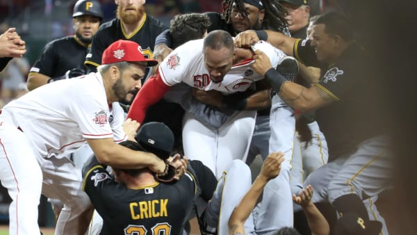 CINCINNATI, OHIO - JULY 30: Amir Garrett #50 (middle white shirt with out hat) of the Cincinnati Reds engages members of the Pittsburgh Pirates during a bench clearing altercation in the 9th inning of the game  at Great American Ball Park on July 30, 2019 in Cincinnati, Ohio. (Photo by Andy Lyons/Getty Images)