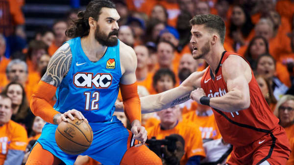 OKLAHOMA CITY, OKLAHOMA - APRIL 19: Steven Adams #12 of the Oklahoma City Thunder backs down Meyers Leonard #11 of the Portland Trail Blazers during game three of the Western Conference quarterfinals at Chesapeake Energy Arena on April 19, 2019 in Oklahoma City, Oklahoma. NOTE TO USER: User expressly acknowledges and agrees that, by downloading and or using this photograph, User is consenting to the terms and conditions of the Getty Images License Agreement.  (Photo by Cooper Neill/Getty Images)