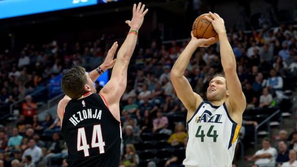 SALT LAKE CITY, UT - OCTOBER 16:  Bojan Bogdanovic #44 of the Utah Jazz shoots over Mario Hezonja #44 of the Portland Trail Blazers at Vivint Smart Home Arena on October 16, 2019 in Salt Lake City, Utah. NOTE TO USER: User expressly acknowledges and agrees that, by downloading and or using this photograph, User is consenting to the terms and conditions of the Getty Images License Agreement.  (Photo by Alex Goodlett/Getty Images)