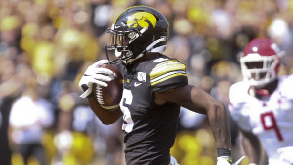 IOWA CITY, IOWA- SEPTEMBER 7:  Wide receiver Ihmir Smith-Marsette #6 of the Iowa Hawkeyes rushes up field for a touchdown during the second half past linebacker Tyreek Maddox-Williams #9 of the Rutgers Scarlet Knights on September 7, 2019 at Kinnick Stadium in Iowa City, Iowa.  (Photo by Matthew Holst/Getty Images)