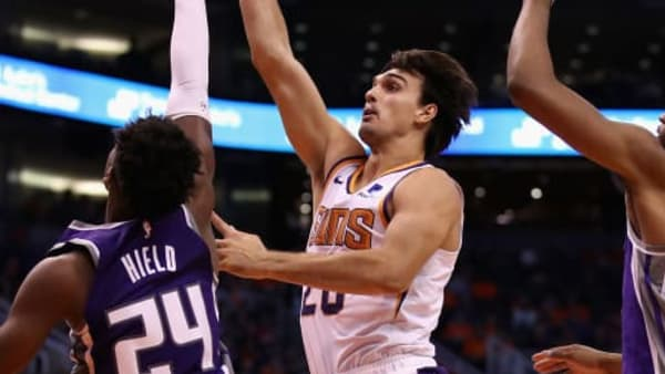 PHOENIX, ARIZONA - OCTOBER 23: Dario Saric #20 of the Phoenix Suns puts up a shot over Buddy Hield #24 and Marvin Bagley III #35 of the Sacramento Kings during the second half of the NBA game at Talking Stick Resort Arena on October 23, 2019 in Phoenix, Arizona. The Suns defeated the Kings 124-95. NOTE TO USER: User expressly acknowledges and agrees that, by downloading and/or using this photograph, user is consenting to the terms and conditions of the Getty Images License Agreement (Photo by Christian Petersen/Getty Images)