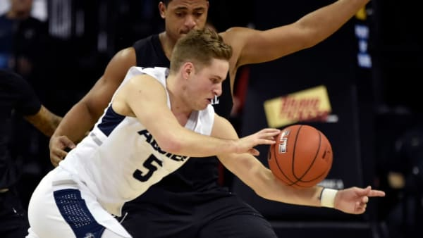 LAS VEGAS, NEVADA - MARCH 16:  Sam Merrill #5 of the Utah State Aggies drives the ball against the San Diego State Aztecs during the championship game of the Mountain West Conference basketball tournament at the Thomas & Mack Center on March 16, 2019 in Las Vegas, Nevada.  Utah State won 64-57.  (Photo by David Becker/Getty Images)
