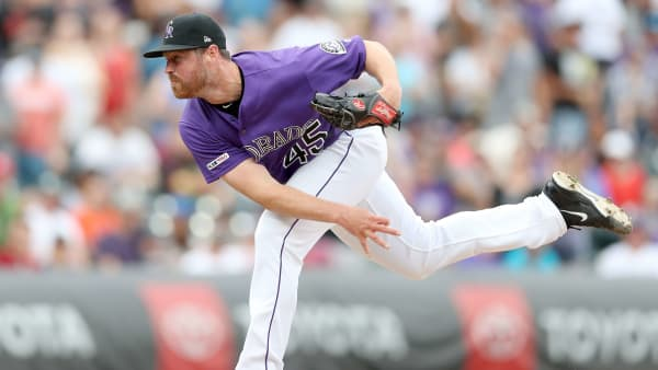 DENVER, COLORADO - AUGUST 04: Pitcher Scott Oberg #45 of the Colorado Rockies throws in the ninth inning against the San Francisco Giants at Coors Field on August 04, 2019 in Denver, Colorado. (Photo by Matthew Stockman/Getty Images)