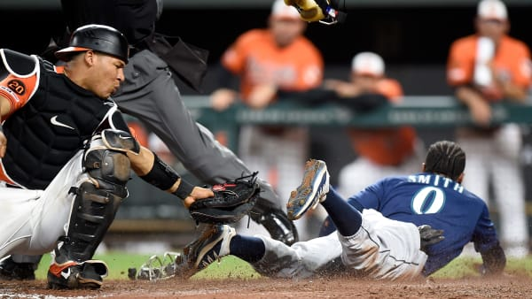 BALTIMORE, MD - SEPTEMBER 21:  Mallex Smith #0 of the Seattle Mariners slides into home plate to score the game winning run in the 13th inning ahead of the tag of Pedro Severino #28 of the Baltimore Orioles at Oriole Park at Camden Yards on September 21, 2019 in Baltimore, Maryland.  (Photo by Greg Fiume/Getty Images)