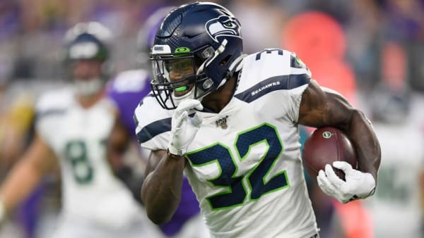 MINNEAPOLIS, MN - AUGUST 18: Chris Carson #32 of the Seattle Seahawks carries the ball against the Minnesota Vikings during the first quarter of the preseason game at U.S. Bank Stadium on August 18, 2019 in Minneapolis, Minnesota. (Photo by Hannah Foslien/Getty Images)