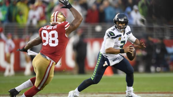 SANTA CLARA, CA - DECEMBER 16:  Russell Wilson #3 of the Seattle Seahawks rools out to pass pursued by Ronald Blair #98 of the San Francisco 49ers during an NFL football game at Levi's Stadium on December 16, 2018 in Santa Clara, California.  (Photo by Thearon W. Henderson/Getty Images)