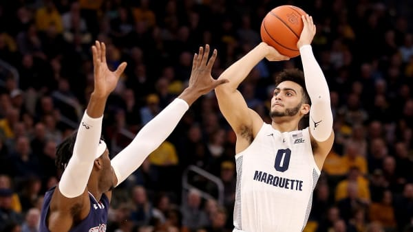 MILWAUKEE, WISCONSIN - FEBRUARY 05:  Markus Howard #0 of the Marquette Golden Eagles attempts a shot while being guarded by Sedee Keita #0 of the St. John's Red Storm in the first half at the Fiserv Forum on February 05, 2019 in Milwaukee, Wisconsin. (Photo by Dylan Buell/Getty Images)