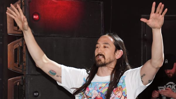 LAS VEGAS, NEVADA - JUNE 13:  DJ/producer Steve Aoki performs as he hosts the worldwide premiere of the new Viva Vision light show featuring a six-minute musical montage of his hits at the Fremont Street Experience on June 13, 2019 in Las Vegas, Nevada. The new show offers visitors a first look at the ongoing USD 32 million renovation to the world's largest video screen on a canopy that spans five blocks in downtown Las Vegas.  (Photo by Ethan Miller/Getty Images)