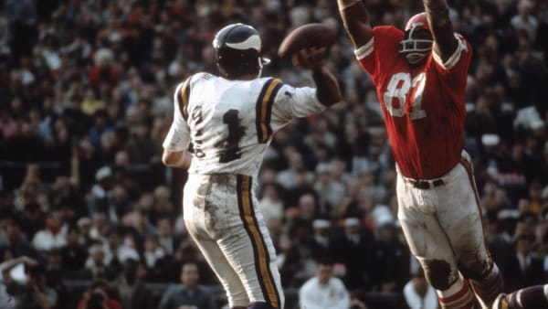 NEW ORLEANS, LA - JANUARY 11: Joe Kapp #11 of the Minnesota Vikings drops back to pass under pressure from Aaron Brown #87 of the Kansas City Chiefs during Super Bowl IV on January 11, 1970 at Tulane Stadium in New Orleans, Louisiana. The Chiefs won the Super Bowl 23-7. (Photo by Focus on Sport/Getty Images)