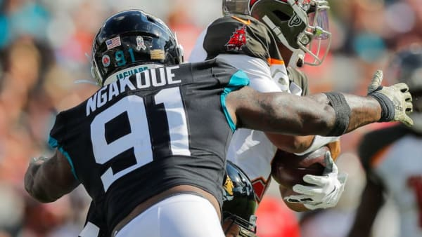 Yannick Ngakoue makes a tackles in a game against the Buccaneers.