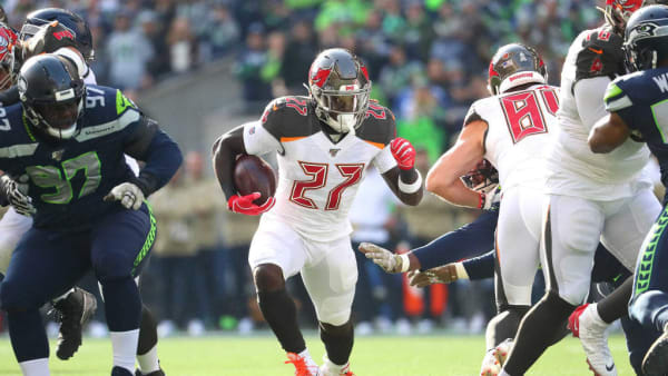 SEATTLE, WASHINGTON - NOVEMBER 03: Ronald Jones #27 of the Tampa Bay Buccaneers runs with the ball in the first quarter against the Seattle Seahawks during their game at CenturyLink Field on November 03, 2019 in Seattle, Washington. (Photo by Abbie Parr/Getty Images)