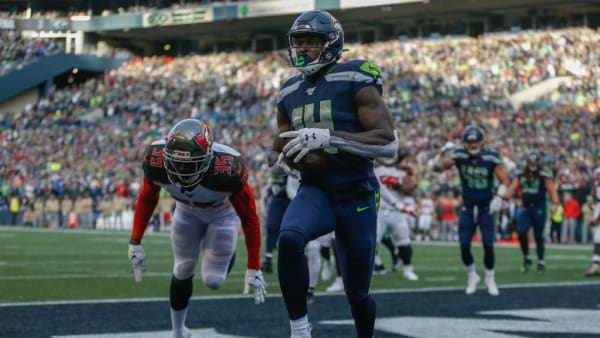SEATTLE, WA - NOVEMBER 03:  Wide receiver DK Metcalf #14 of the Seattle Seahawks scores a two-point conversion in the third quarter against the Tampa Bay Buccaneers at CenturyLink Field on November 3, 2019 in Seattle, Washington. The Seahawks beat the Buccaneers 40-34 in overtime.  (Photo by Otto Greule Jr/Getty Images)