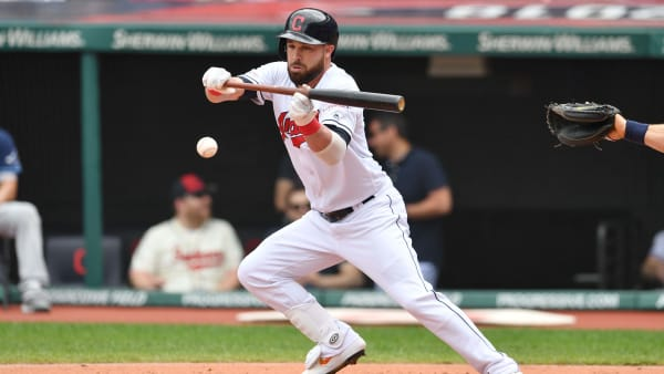 CLEVELAND, OHIO - MAY 26: Jason Kipnis #22 of the Cleveland Indians bunts during the first inning against the Tampa Bay Rays at Progressive Field on May 26, 2019 in Cleveland, Ohio. (Photo by Jason Miller/Getty Images)