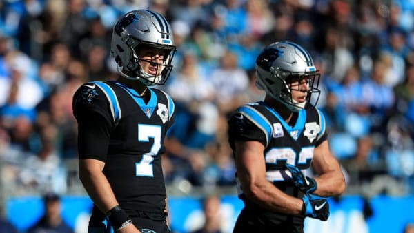 CHARLOTTE, NORTH CAROLINA - NOVEMBER 03: Teammates Kyle Allen #7 and Christian McCaffrey #22 of the Carolina Panthers during their game at Bank of America Stadium on November 03, 2019 in Charlotte, North Carolina. (Photo by Streeter Lecka/Getty Images)