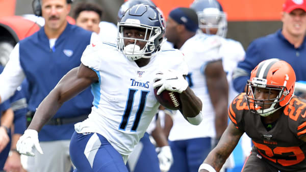 CLEVELAND, OHIO - SEPTEMBER 08: Wide receiver A.J. Brown #11 of the Tennessee Titans rushes while under pressure from strong safety Damarious Randall #23 of the Cleveland Browns during the second half at FirstEnergy Stadium on September 08, 2019 in Cleveland, Ohio. The Titans defeated the Browns 43-13.  (Photo by Jason Miller/Getty Images)
