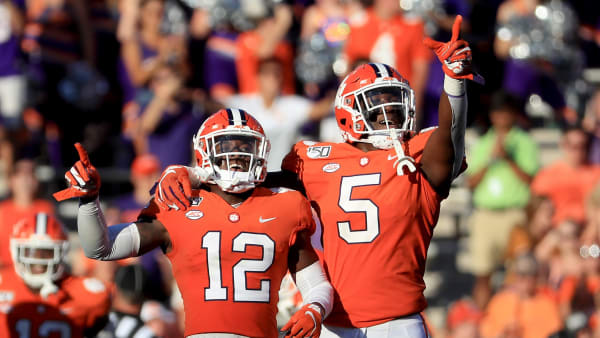 CLEMSON, SOUTH CAROLINA - SEPTEMBER 07: Teammates K'Von Wallace #12 and K.J. Henry #5 of the Clemson Tigers react after a defensive stop against the Texas A&M Aggies during their game at Memorial Stadium on September 07, 2019 in Clemson, South Carolina. (Photo by Streeter Lecka/Getty Images)