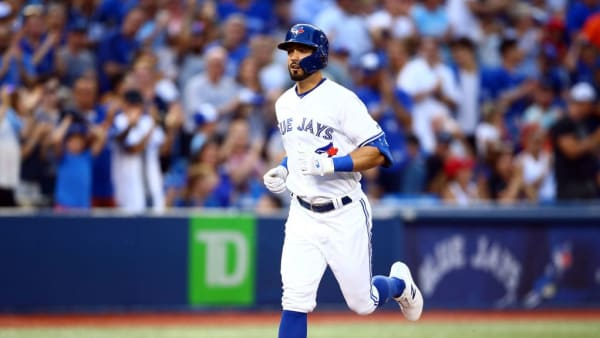 TORONTO, ON - AUGUST 13:  Randal Grichuk #15 of the Toronto Blue Jays hits a solo home run in the second inning during a MLB game against the Texas Rangers at Rogers Centre on August 13, 2019 in Toronto, Canada.  (Photo by Vaughn Ridley/Getty Images)