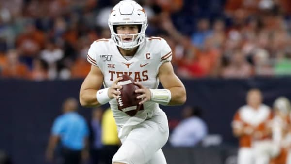 HOUSTON, TX - SEPTEMBER 14:  Sam Ehlinger #11 of the Texas Longhorns rolls out to pass in the third quarter against the Rice Owls at NRG Stadium on September 14, 2019 in Houston, Texas.  (Photo by Tim Warner/Getty Images)