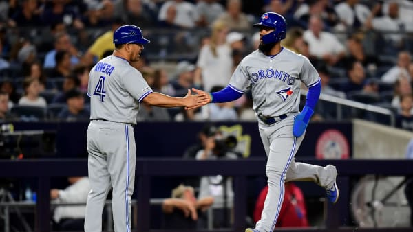 NEW YORK, NEW YORK - SEPTEMBER 20: Teoscar Hernandez #37 of the Toronto Blue Jays high fives third base coach Luis Rivera #4 of the Toronto Blue Jays after a home run in the seventh inning of their game against the New York Yankees at Yankee Stadium on September 20, 2019 in the Bronx borough of New York City. (Photo by Emilee Chinn/Getty Images)