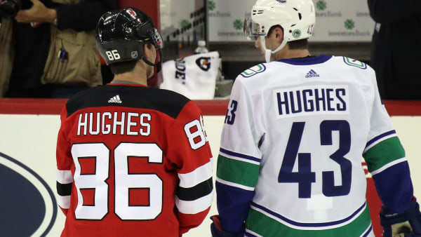 NEWARK, NEW JERSEY - OCTOBER 19: Brothers Jack Hughes #86 of the New Jersey Devils and Quinn Hughes #43 of the Vancouver Canucks skates in warm-ups prior to their game at the Prudential Center on October 19, 2019 in Newark, New Jersey. (Photo by Bruce Bennett/Getty Images)