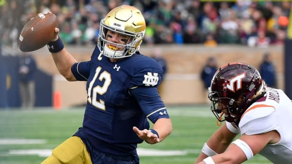 SOUTH BEND, INDIANA - NOVEMBER 02: Ian Book #12 of the Notre Dame Fighting Irish scrambles in the first half against the Virginia Tech Hokies at Notre Dame Stadium on November 02, 2019 in South Bend, Indiana. (Photo by Quinn Harris/Getty Images)