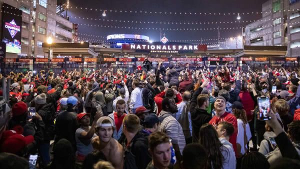 WASHINGTON, DC - OCTOBER 30: Washington Nationals fans stream into the streets outside of Nationals Park celebrating the Nationals World Series victory on October 30, 2019 in Washington, DC. The Washington Nationals defeated the Houston Astros 6-2 in Game 7 of the World Series bringing home the first World Series Championship in franchise history and the first to Washington, DC since 1924. (Photo by Samuel Corum/Getty Images)