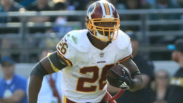 JACKSONVILLE, FLORIDA - DECEMBER 16: Adrian Peterson #26 of the Washington Redskins runs for yardage during the game against the Jacksonville Jaguars at TIAA Bank Field on December 16, 2018 in Jacksonville, Florida. (Photo by Sam Greenwood/Getty Images)