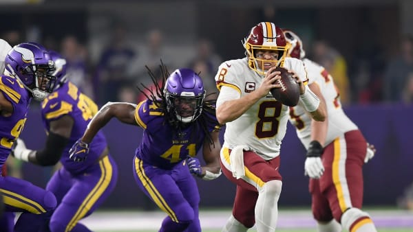 MINNEAPOLIS, MINNESOTA - OCTOBER 24: Quarterback Case Keenum #8 of the Washington Redskins runs against Anthony Harris #41 of the Minnesota Vikings  n the game at U.S. Bank Stadium on October 24, 2019 in Minneapolis, Minnesota. (Photo by Hannah Foslien/Getty Images)