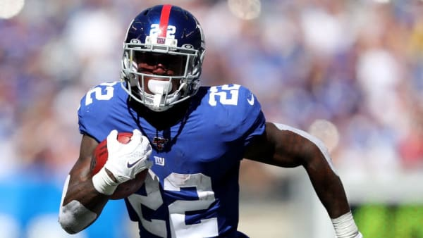 EAST RUTHERFORD, NEW JERSEY - SEPTEMBER 29:  Wayne Gallman Jr. #22 of the New York Giants carries the ball in the second quarter against the Washington Redskins at MetLife Stadium on September 29, 2019 in East Rutherford, New Jersey. (Photo by Elsa/Getty Images)