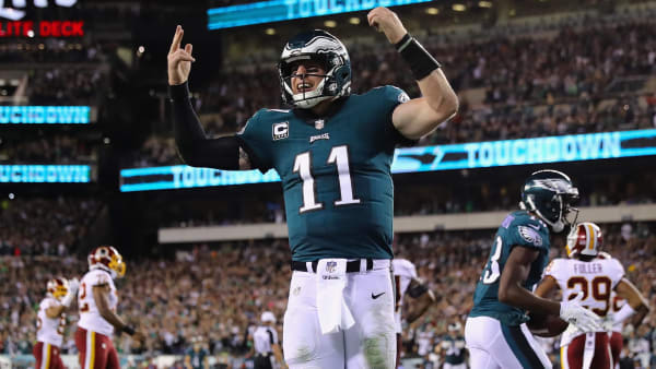 PHILADELPHIA, PA - OCTOBER 23: Quarterback Carson Wentz #11 of the Philadelphia Eagles celebrates a touchdown by teammate Nelson Agholor #13  during the fourth quarter of the game against the Washington Redskins at Lincoln Financial Field on October 23, 2017 in Philadelphia, Pennsylvania.  (Photo by Elsa/Getty Images)