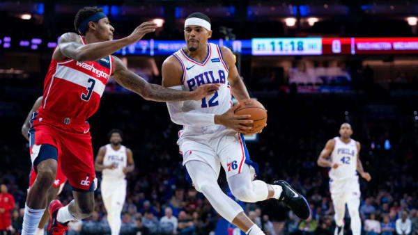 PHILADELPHIA, PA - OCTOBER 18: Tobias Harris #12 of the Philadelphia 76ers drives to the basket against Bradley Beal #3 of the Washington Wizards in the first quarter of the preseason game at the Wells Fargo Center on October 18, 2019 in Philadelphia, Pennsylvania. NOTE TO USER: User expressly acknowledges and agrees that, by downloading and or using this photograph, User is consenting to the terms and conditions of the Getty Images License Agreement.(Photo by Mitchell Leff/Getty Images)