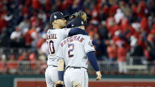 WASHINGTON, DC - OCTOBER 26:  Yuli Gurriel #10 and Alex Bregman #2 of the Houston Astros celebrate their teams 8-1 win against the Washington Nationals in Game Four of the 2019 World Series at Nationals Park on October 26, 2019 in Washington, DC. (Photo by Rob Carr/Getty Images)