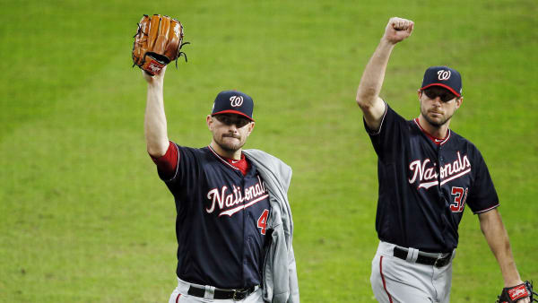 HOUSTON, TEXAS - OCTOBER 29:  Daniel Hudson #44 and Max Scherzer #31 of the Washington Nationals celebrate their teams 7-2 win against the Houston Astros in Game Six of the 2019 World Series at Minute Maid Park on October 29, 2019 in Houston, Texas. (Photo by Bob Levey/Getty Images)