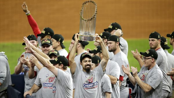 HOUSTON, TEXAS - OCTOBER 30:  Anthony Rendon #6 of the Washington Nationals hoists the Commissioners Trophy after defeating the Houston Astros 6-2 in Game Seven to win the 2019 World Series in Game Seven of the 2019 World Series at Minute Maid Park on October 30, 2019 in Houston, Texas. (Photo by Bob Levey/Getty Images)