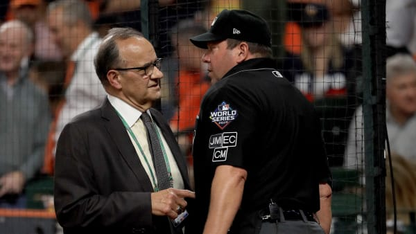 HOUSTON, TEXAS - OCTOBER 29:  Major League Baseball's chief baseball officer Joe Torre speaks with umpire Sam Holbrook #34 during the seventh inning in Game Six of the 2019 World Series between the Houston Astros and the Washington Nationals at Minute Maid Park on October 29, 2019 in Houston, Texas. (Photo by Mike Ehrmann/Getty Images)