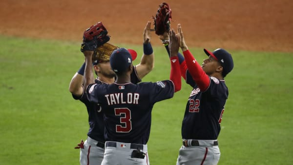 HOUSTON, TEXAS - OCTOBER 23:  Juan Soto #22, Michael A. Taylor #3 and Gerardo Parra #88 of the Washington Nationals celebrate their 12-3 win over the Houston Astros in Game Two of the 2019 World Series at Minute Maid Park on October 23, 2019 in Houston, Texas. (Photo by Tim Warner/Getty Images)