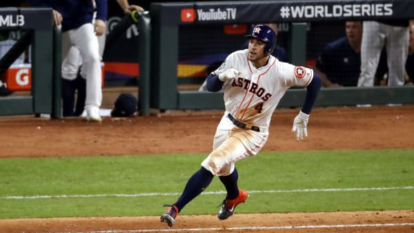 HOUSTON, TEXAS - OCTOBER 22:  George Springer #4 of the Houston Astros hits an RBI double against the Washington Nationals during the eighth inning in Game One of the 2019 World Series at Minute Maid Park on October 22, 2019 in Houston, Texas. (Photo by Tim Warner/Getty Images)
