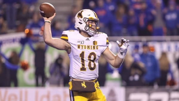 Wyoming QB Tyler Vander Waal prepares to pass the ball in a game against Boise State.