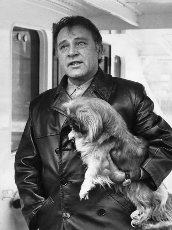 Welsh actor Richard Burton (1925 - 1984) with one of his dogs on board the yacht 'Beatriz' of Bolivia off Tower Pier in London, 17th February 1968. The vessel was hired by Burton and his wife Elizabeth Taylor for two months, during the filming of Burton's new movie 'Where Eagles Dare'. (Photo by Central Press/Hulton Archive/Getty Images)