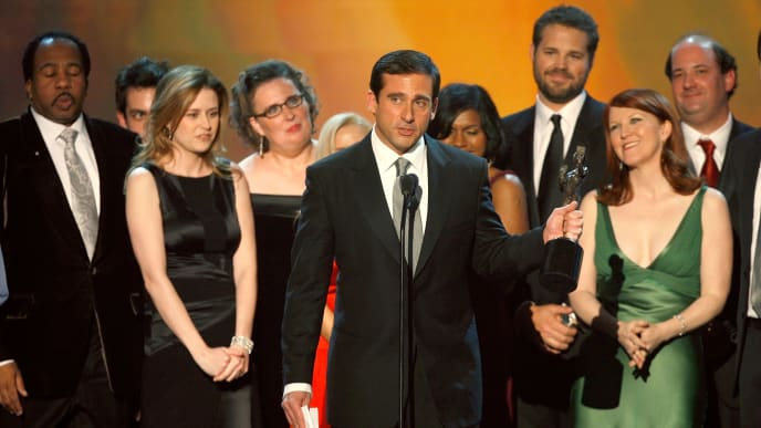 """LOS ANGELES, CA - JANUARY 28:  The cast and crew of """"The Office"""" accept the Outstanding Ensemble in a Comedy Series award onstage at the 13th Annual Screen Actor Guild Awards held at the Shrine Auditorium on January 28, 2007 in Los Angeles, California.  (Photo by Kevin Winter/Getty Images)"""