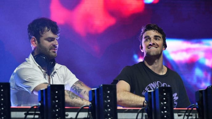 WANTAGH, NEW YORK - JUNE 15: Alex Pall and Andrew Taggart of The Chainsmokers perform during 2019 103.5 KTU KTUphoria presented by Pepsi at Northwell Health at Jones Beach Theater on June 15, 2019 in Wantagh, New York. (Photo by Bryan Bedder/Getty Images for iHeartRadio )