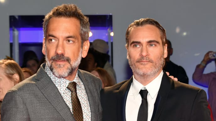 "TORONTO, ONTARIO - SEPTEMBER 09: (L-R) Todd Phillips and Joaquin Phoenix attend the ""Joker"" premiere during the 2019 Toronto International Film Festival at Roy Thomson Hall on September 09, 2019 in Toronto, Canada. (Photo by Amy Sussman/Getty Images)"