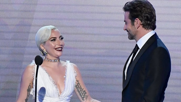 LOS ANGELES, CA - JANUARY 27:  Lady Gaga and Bradley Cooper speak onstage during the 25th Annual Screen Actors Guild Awards at The Shrine Auditorium on January 27, 2019 in Los Angeles, California.  (Photo by Kevork Djansezian/Getty Images)