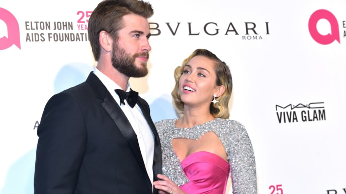 WEST HOLLYWOOD, CA - MARCH 04:  Liam Hemsworth (L) and Miley Cyrus attend the 26th annual Elton John AIDS Foundation's Academy Awards Viewing Party at The City of West Hollywood Park on March 4, 2018 in West Hollywood, California.  (Photo by Rodin Eckenroth/Getty Images)